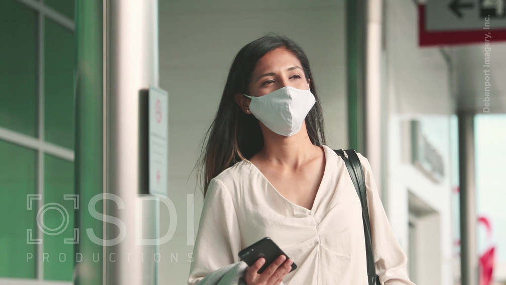 Woman Leaves Airport
