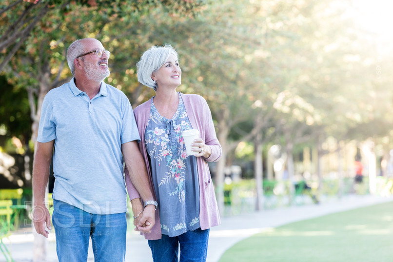 Senior Couple Enjoy Walking Together