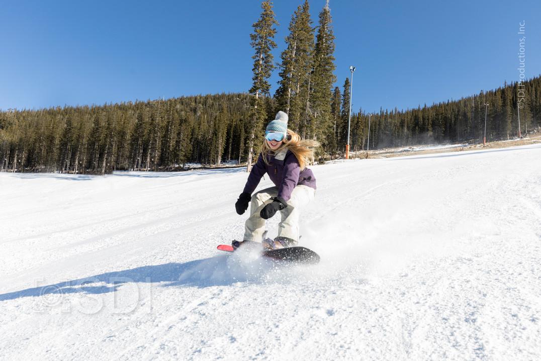 Expert Female Snowboarder