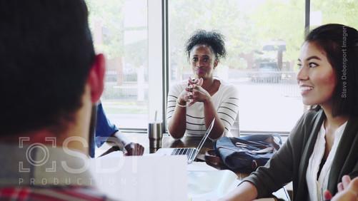 Female Executive Facilitates Meeting