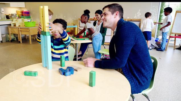 Male Teacher and Kindergarten Student Build with Blocks