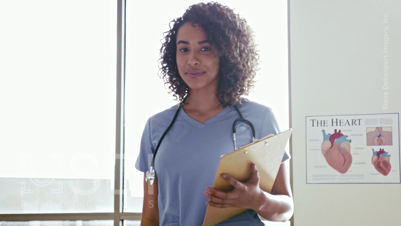 Confident Young Adult Healthcare Professional Smiling