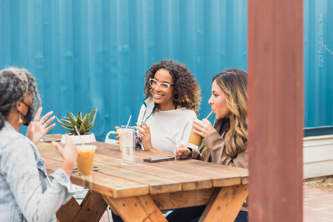Female Friends Meet at Cafe