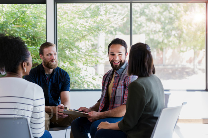 Cheerful Counselor Leading Group Therapy Session