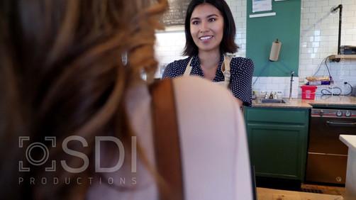 Confident Barista Serves Female Customer
