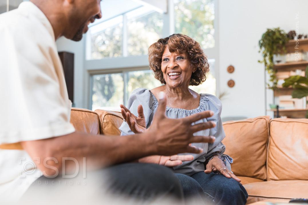 Senior Woman Enjoys Visit with Adult Son