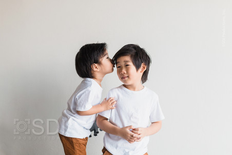 Little Boy Gives Brother Kiss