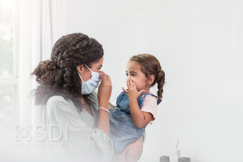 Mother Explains Protective Mask to Daughter