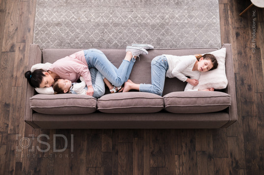 Single Mom and Daughters Napping on Sofa
