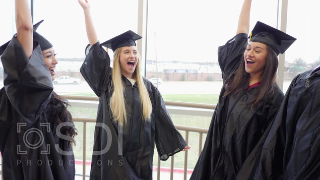 High School Graduates Place Hands Together In Unity
