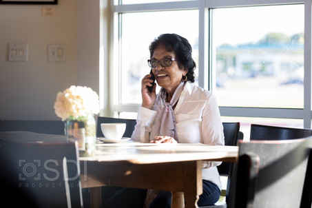 Senior Woman Makes Call on Smart Phone