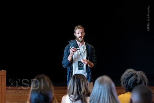 Confident Young Man Addresses People During Seminar