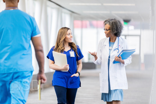 Medical Professionals Walk Along Elevated Walkway
