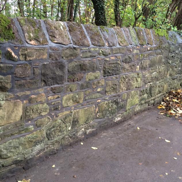 Repair job on boundary wall in Arrowe Park