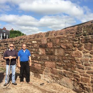 Fallen down sandstone wall