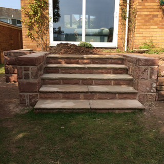 New steps and sandstone wall.