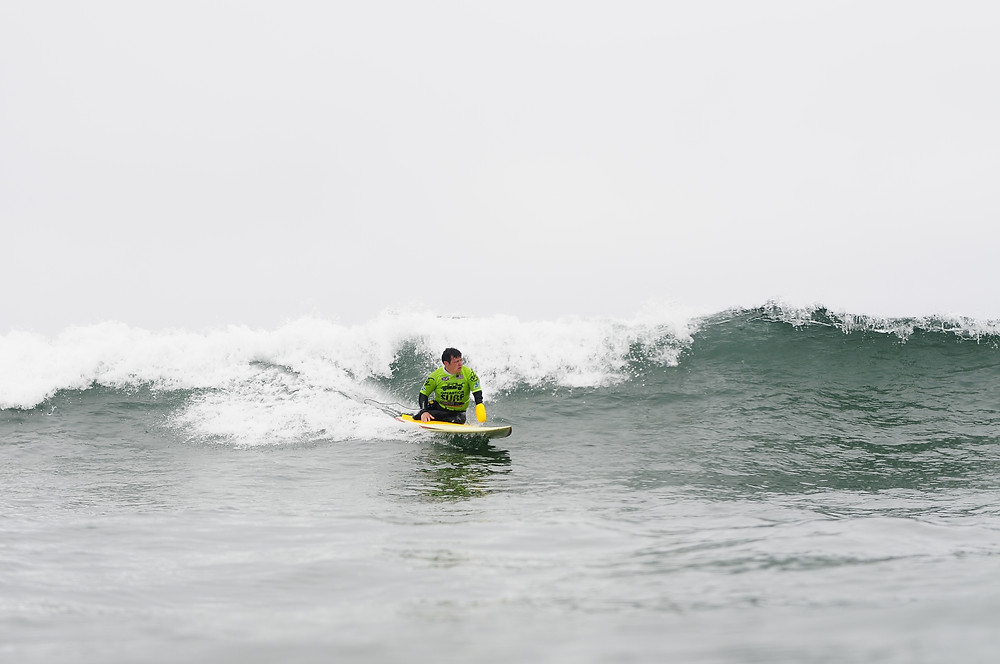 Wounded veteran surfing during a recent Operation Surf camp