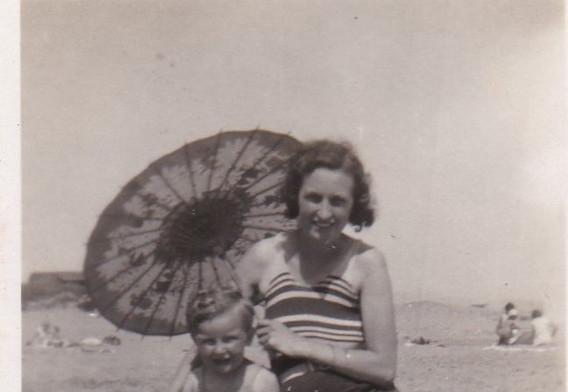 Mum and child on beach 1930s