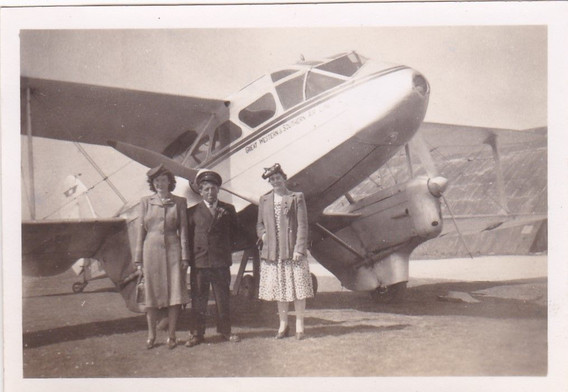 Fashionable ladies with a airplane pilot 1940s