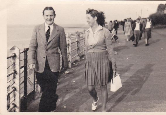 Couple walking the Promenade 1040s