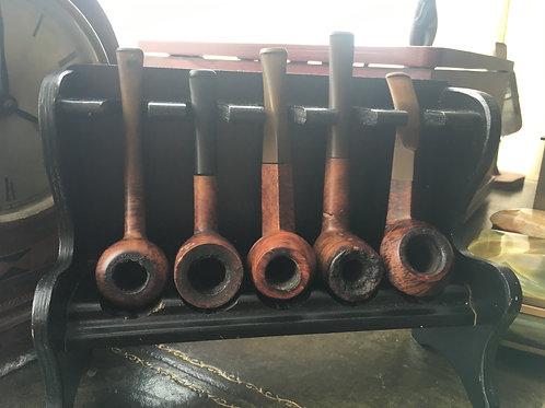 Rack full of Vintage Pipes
