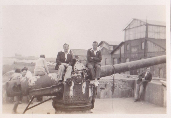 Young men on a gun with open neck shirts 1930s