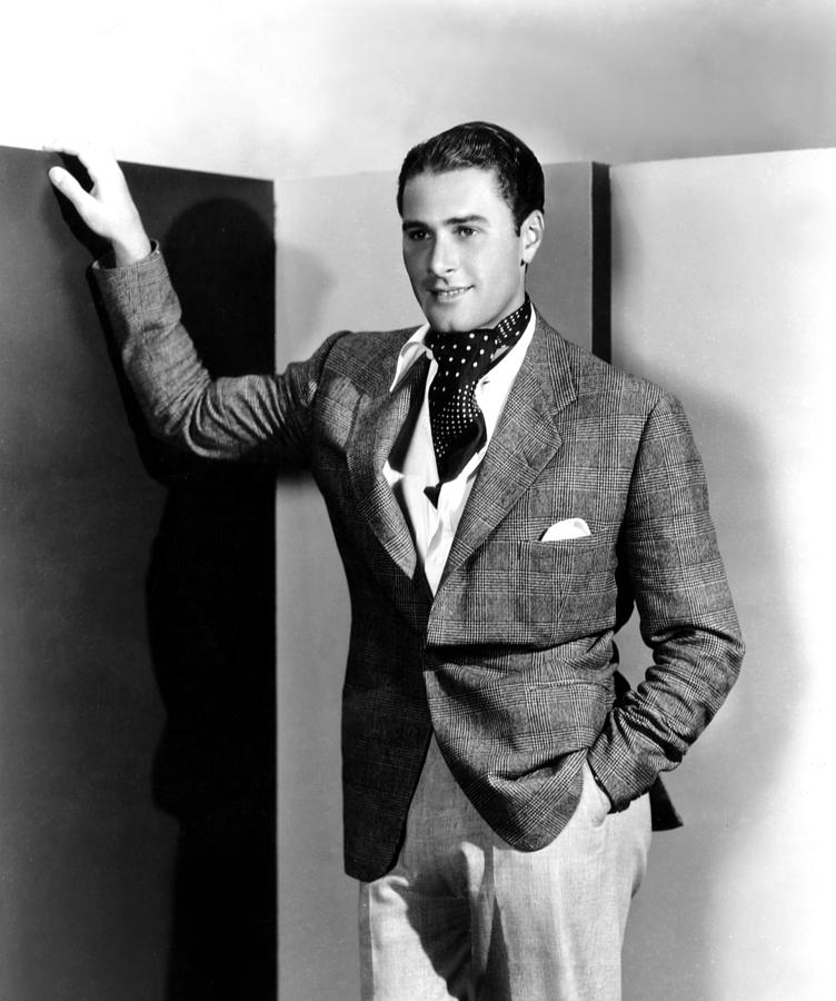Errol Flynn with cravat & open shirt