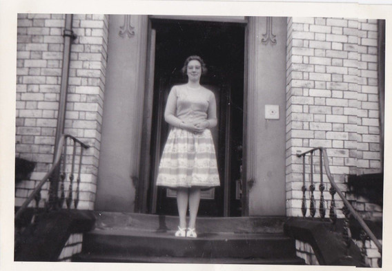 Young lady in a twin set and skirt 1950s