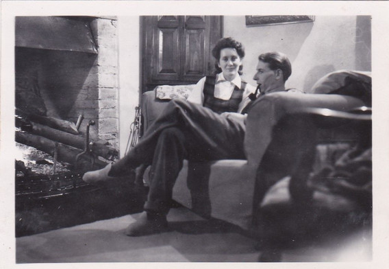 Couple relaxing by the fire 1940s