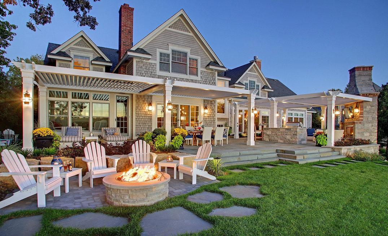 "<img src=""home backyard.jpg"" alt=""beautiful home with struxure pergola and fireplace"">"