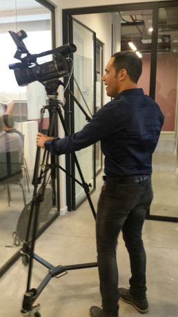 """Teddy Nehmad (תדי נחמד) filming during Lithuanian acceleration week held in """"Start in Haifa"""" startup accelerator"""