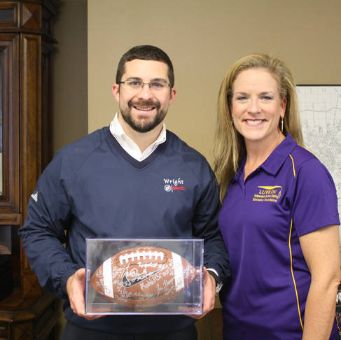 Wright Presented with 2014 Panther Football Team Ball