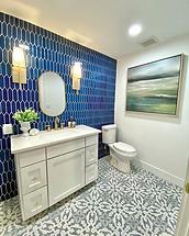 Patterned Tile Flooring in Bathroom and blue tile backsplash