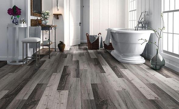 Grey Hardwood Floor Luxury Vinyl Plank in Beautiful Bathroom Remodel