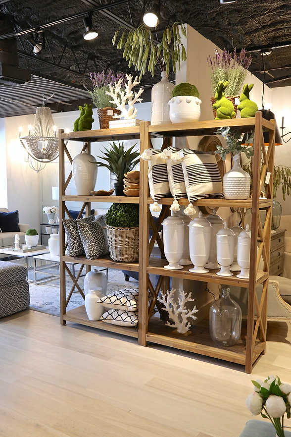 Living room furniture couch hutch bookshelf ottoman chair end table home accessories interior design pillows vases chandelier