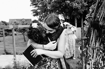 Hugging hug Cuddling cat - Reverend Bryony Wildblood Interfaith Minister Funeral Celebrant Spiritual Counsellor weddings funerals blessings
