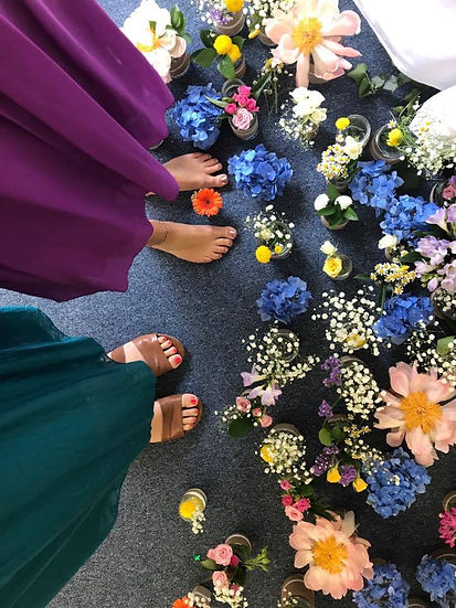 Altar flowers and feet - Cuddling cat - Reverend Bryony Wildblood Interfaith Minister Funeral Celebrant Spiritual Counsellor weddings funerals blessings