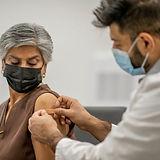 iStock-1292817471_Doctor_Patient_BandAid