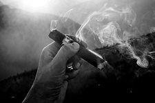 smoke coming from cigar