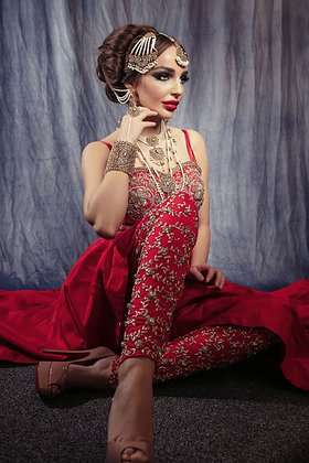 Red waterfall gown with embroidered leggings