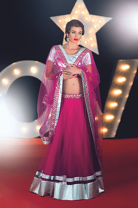 Pink net lehenga and silver blouse