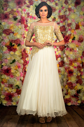 White chiffon gown with gold embellishment