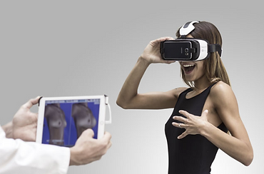 Woman using Crisalix 3D Simulation and Augmented Reality for breast augmentation with Mr Jonathan Adamthwaite