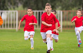 These kids playing soccer can benefit from the progression of nearsightedness often being stopped altogether by corneal reshaping.