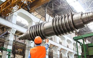 man-standing-beside-heavy-equipment smal