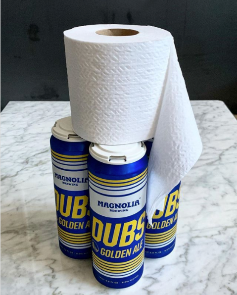beer cans and a roll of toilet paper