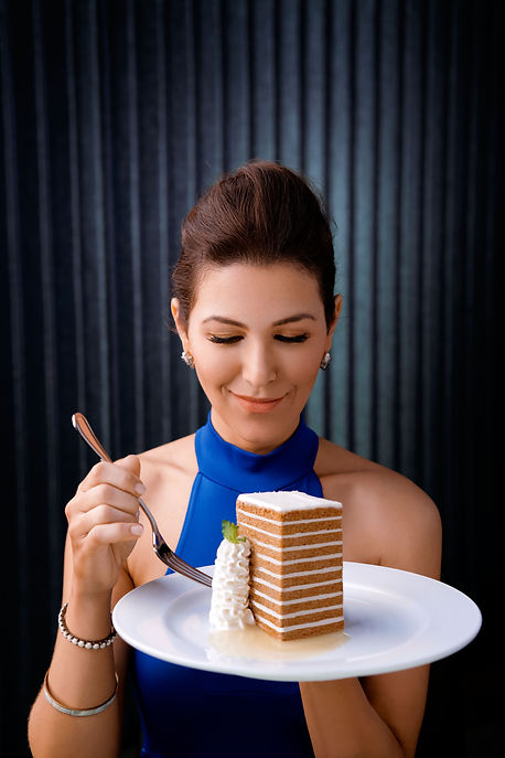 woman in a blue dress eating carrot cake