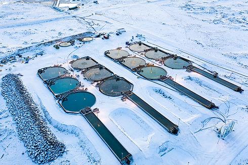 aquaculture pools set amidst a snowy background
