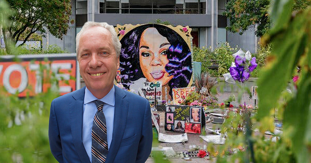 Louisville Mayor Greg Fisher in front of Breonna Taylor mural