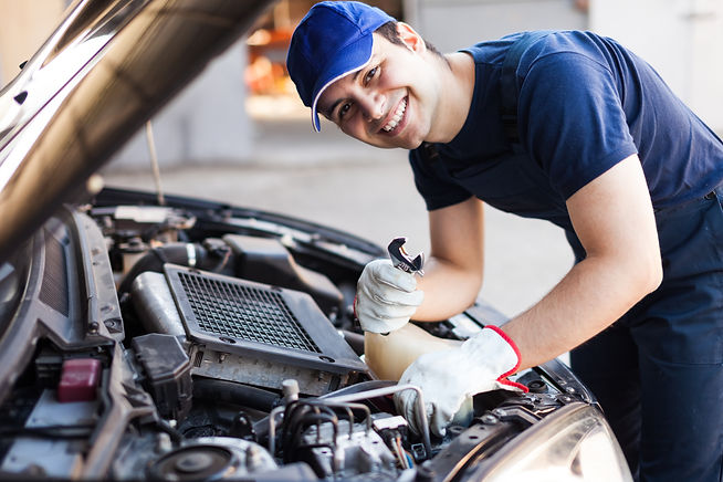 Mechanic working on a car engine.jpg